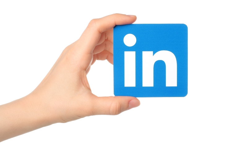 KIEV UKRAINE - MARCH 7 2015:Hand holds Linkedin logo